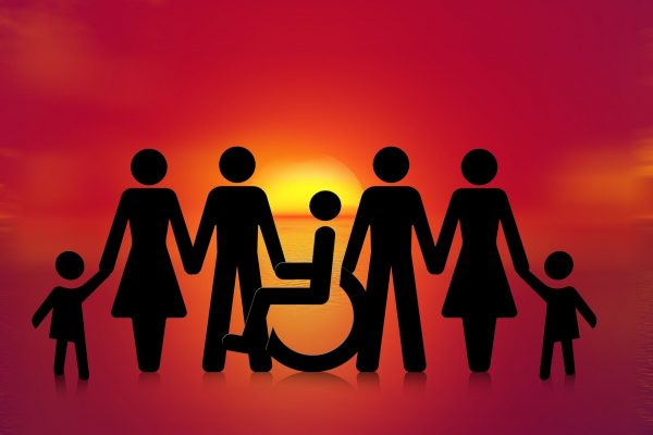 Sunset team showing silhouettes of people of all genders and ages, including a wheelchair user