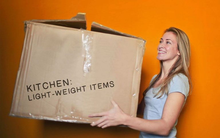 Blond Woman Carrying Box With Kitchen Items During Relocation On Orange Background