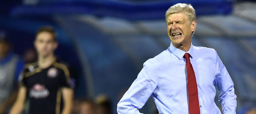 Arsenal's French Coach Arsene Wenger reacts during the UEFA Champions League Group F football match between GNK Dinamo Zagreb and Arsenal FC at Maksimir Stadium in Zagreb on September 16, 2015.  AFP PHOTO / ANDREJ ISAKOVIC