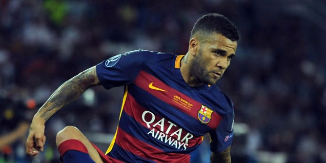Barcelona's Brazilian defender Dani Alves controls the ball during the UEFA Super Cup final football match between FC Barcelona and Sevilla FC on August 11, 2015 at the Boris Paichadze Dinamo Arena in Tbilisi. AFP PHOTO / VANO SHLAMOV