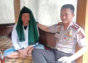 Pembawa bendera HTI (kiri) dan Kapolres Garut AKBP Budi Satria Wiguna/Dok istimewa.