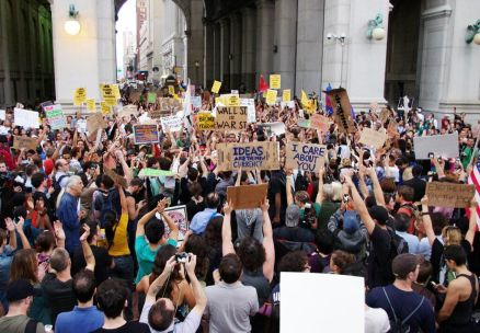Thousands of protesters march down Wall Street, NY.