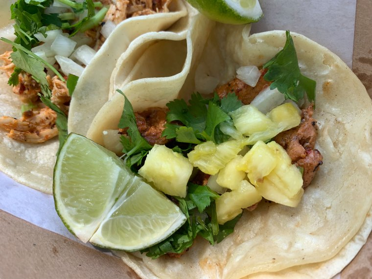 Al Pastor Tacos - pork and pineapple with cilantro and onion - from Comalli Taqueria
