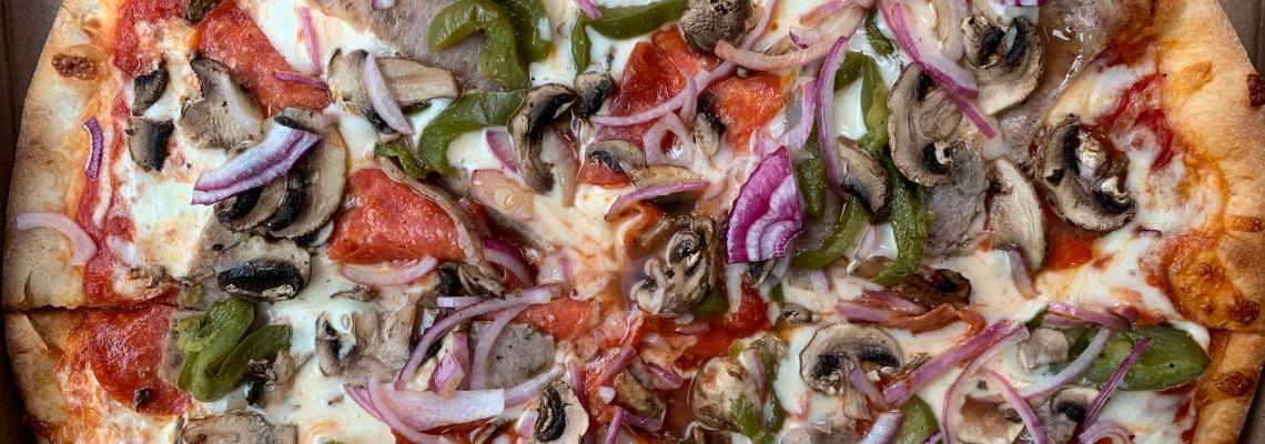 Oliverio's house special pizza topped with pepperoni, sausage, mushrooms, onion and peppers