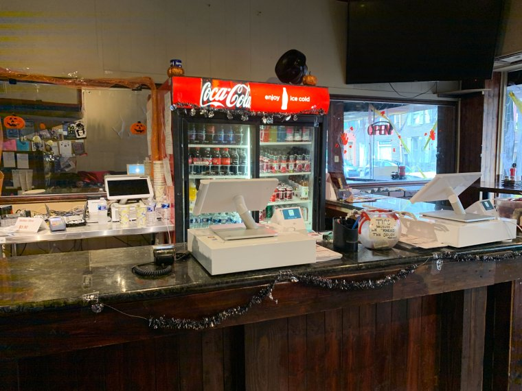 A Coca-Cola case behind the counter at TommyBoy's