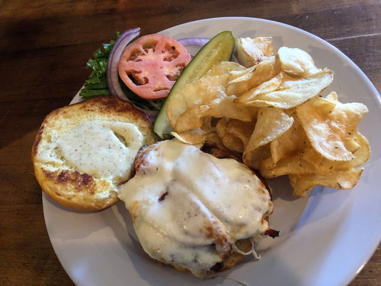 Grilled chicken sandwich with chips and pickle from Barrel & Ale