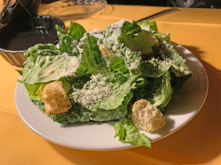 A Caesar salad with cheese and croutons from Judy's on Cherry