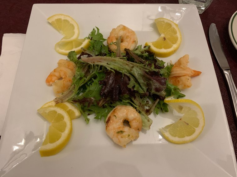 A large salad with jumbo shrimp and four lemon wedges from the Reading Liederkranz