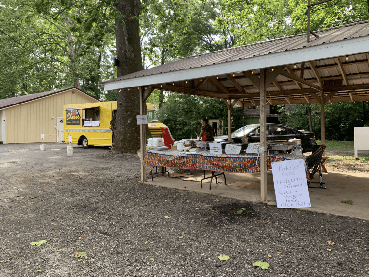 Picture of a food stand under a pavilion with a sign advertising Spanish food
