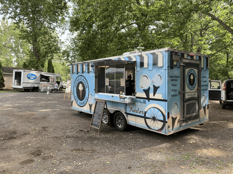 Photo of the Sweet Ride Ice Cream food truck under a tree
