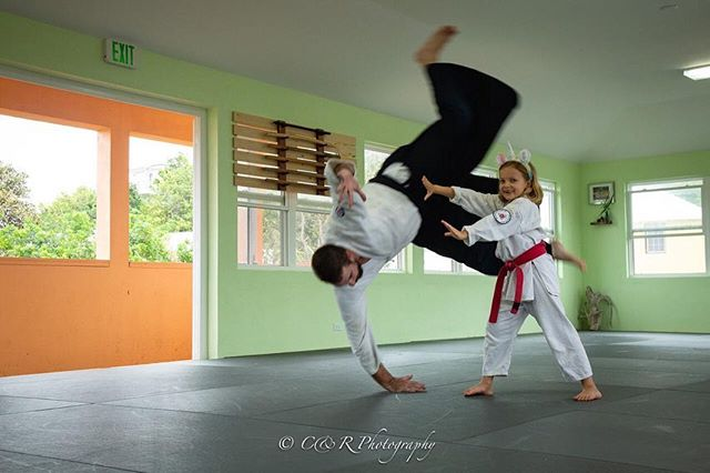 Chris is thrown by a student and also by adult Kim during Saturday mornings kids class. Photos by Roseli