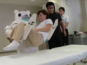 Robear lifting a person off the bed