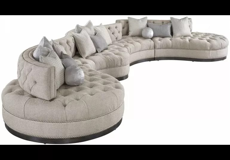 oversized dove grey sectional with curved lines tufted cushions and nailhead trim