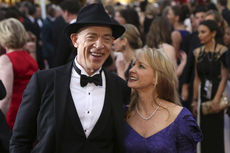 "J.K. Simmons, best supporting actor nominee for his role in ""Whiplash"" and his wife Michelle Schumacher arrive at the 87th Academy Awards in Hollywood, California February 22, 2015"