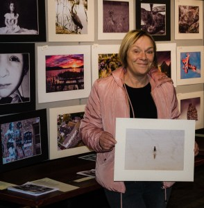 Bernie Delaney holding the photograph which won Judges choice Happy Snappers photography award.