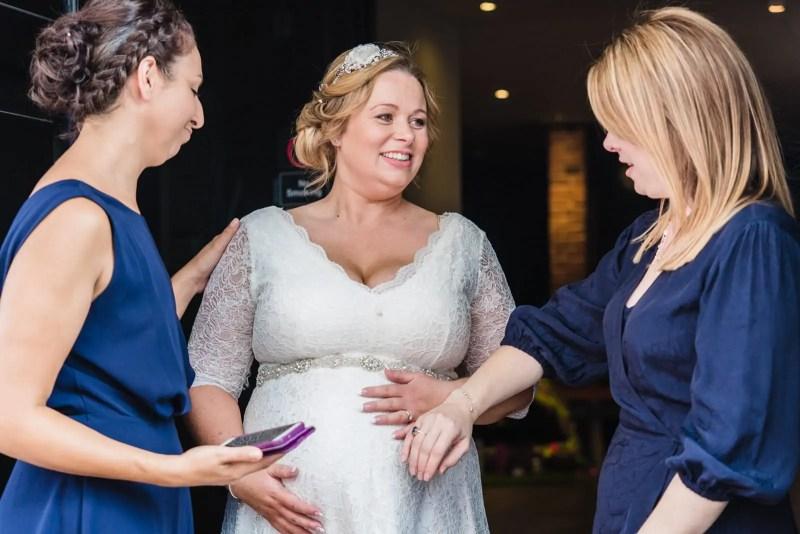 pregnant bride with bridesmaids