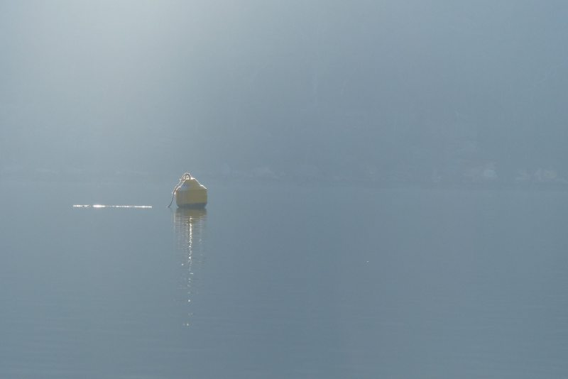 Buoy with plain blue background
