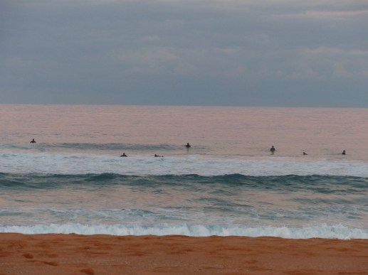 Surfers floating over the relics of yesterday's lagoon