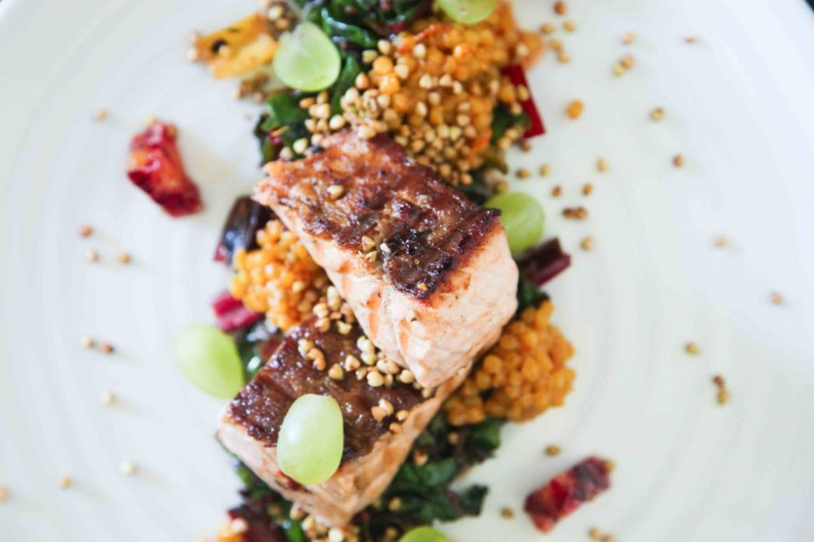 Berries and Spice | Crispy Salmon with Ruby Chard, Giant Couscous and Grapes
