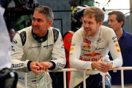 Five-time 500cc MotoGP world champion Mick Doohan and Sebastian Vettel