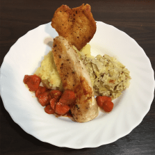 Crispy chicken with mashed potatoes, caramelized onions, and leek chutney