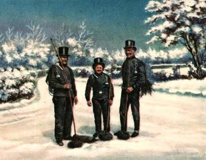 drei Schornsteinfeger im Schnee