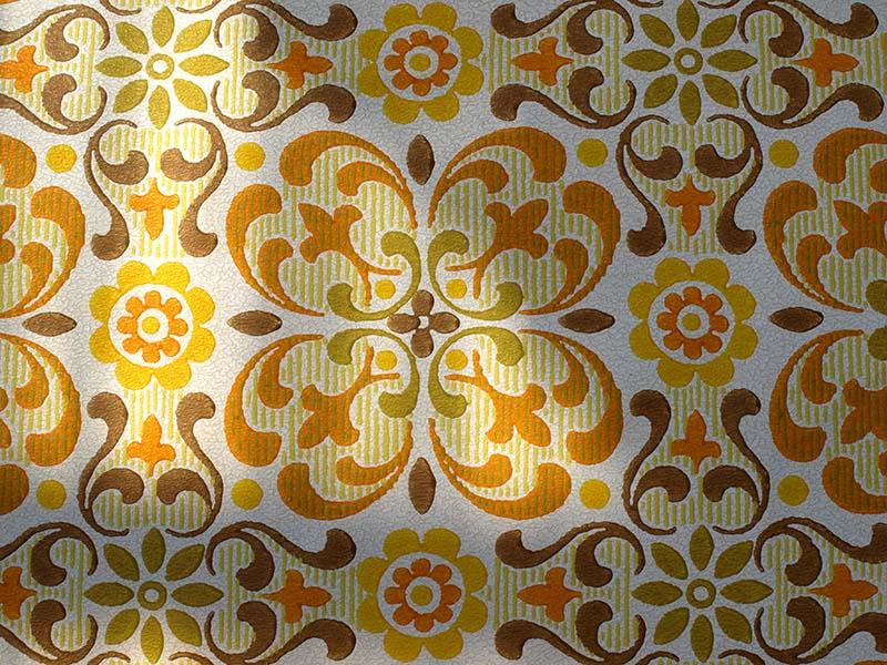 florale Tapete aus den 70er Jahren in gelb-orange-braun-Tönen