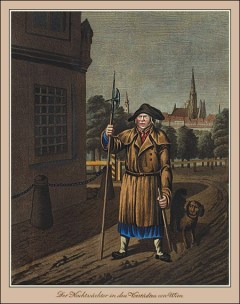 Mann mit Hund und Stab bei seinem Rundgang