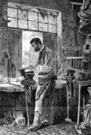 Schlosser in seiner Werkstatt am Schraubstock