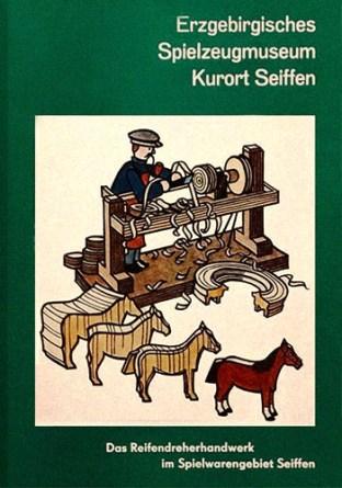 Heftcover. Holzfiguren und Drechsler
