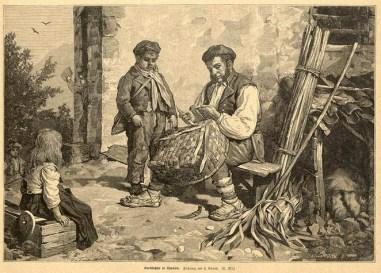 Mann flicht eckigen Korb, zwei Kinder schauen dabei zu