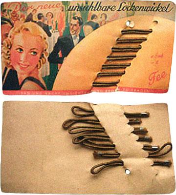 Farbfoto: in Pappkarte steckende, umwickelte Rundgummis - 1920
