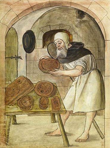Buchmalerei: Buel steht vor Tisch mit fertigen Lebkuchen und hält einen weiteren großen in Händen - 1520