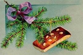 Weihnachtskarte: an Tannenzweig hängender Lebkuchen - 1906