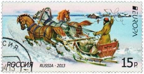 Briefmarke: Troikragefährt mit Kufen unterwegs in Winterlandschaft