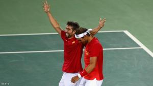 RIO DE JANEIRO, BRAZIL - AUGUST 12:  Marc Lopez and Rafael Nadal of Spain celebrate match point during the Men's Doubles Gold medal match against Horia Tecau and Florin Mergea of Romania on Day 7 of the Rio 2016 Olympic Games at the Olympic Tennis Centre on August 12, 2016 in Rio de Janeiro, Brazil.  (Photo by Clive Brunskill/Getty Images)