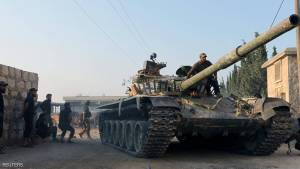 Rebel fighters ride a tank in an artillery academy of Aleppo, Syria, August 6, 2016. REUTERS/Ammar Abdullah