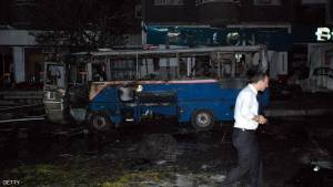 A man walks past a burned bus where at least seven people were killed and dozens wounded when a car bomb blew up on August 20, 2012 in the centre of Turkey's south-eastern city of Gaziantep, a local security source told AFP today. The powerful blast went off close to a police station, setting fire to several vehicles including a city bus, the source said. Rebels from the outlawed Kurdistan Workers' Party (PKK) are active in Turkey's Kurdish-majority south-east. AFP PHOTO / IHLAS NEWS AGENCY  --TURKEY OUT--        (Photo credit should read -/AFP/GettyImages)