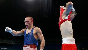 2016 Rio Olympics - Boxing - Quarterfinal - Men's Bantam (56kg) Quarterfinals Bout 223 - Riocentro - Pavilion 6 - Rio de Janeiro, Brazil - 16/08/2016. Vladimir Nikitin (RUS) of Russia reacts next to Michael Conlan (IRL) of Ireland. REUTERS/Peter Cziborra FOR EDITORIAL USE ONLY. NOT FOR SALE FOR MARKETING OR ADVERTISING CAMPAIGNS.