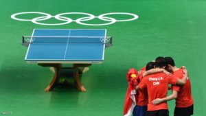 China's Xu Xin, Zhang Jike, and Ma Long celebrate winning the men's team gold medal table tennis match against Japan at the Riocentro venue during the Rio 2016 Olympic Games in Rio de Janeiro on August 17, 2016. / AFP / Luis Acosta        (Photo credit should read LUIS ACOSTA/AFP/Getty Images)