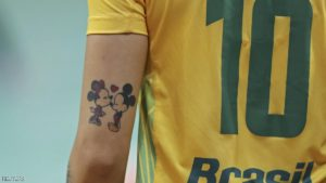 2016 Rio Olympics - Handball - Preliminary - Women's Preliminary Group A Montenegro v Brazil - Future Arena - Rio de Janeiro, Brazil - 14/08/2016. Minnie and Mickey tattoo on Jessica Quintino (BRA) of Brazil. REUTERS/Damir Sagolj FOR EDITORIAL USE ONLY. NOT FOR SALE FOR MARKETING OR ADVERTISING CAMPAIGNS.