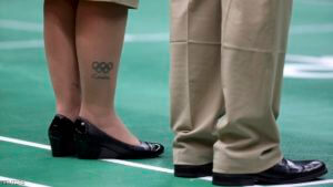 "2016 Rio Olympics - Badminton - Women's Singles Group Play - Riocentro - Pavilion 4 - Rio de Janeiro, Brazil - 14/08/2016. A tattoo of the Olympic rings with the word ""London"" beneath it is seen on the leg of one of the umpires. REUTERS/Marcelo del Pozo FOR EDITORIAL USE ONLY. NOT FOR SALE FOR MARKETING OR ADVERTISING CAMPAIGNS."