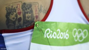 2016 Rio Olympics - Athletics - Final - Women's Longjump Final - Olympic Stadium - Rio de Janeiro, Brazil - 17/08/2016. Tattoos are pictured on the back of Ivana Spanovic (SRB) of Serbia as she prepares to compete. REUTERS/Dylan Martinez  FOR EDITORIAL USE ONLY. NOT FOR SALE FOR MARKETING OR ADVERTISING CAMPAIGNS.