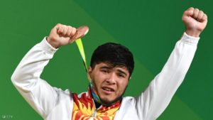 "(FILES) Picture taken on August 9,2016 shows Kirghyzstan's Izzat Artykov posing with his bronze medal on the podium of the Men's 69kg weightlifting competition at the Rio 2016 Olympic Games in Rio de Janeiro.  Izzat Artykov, who won the bronze medal in the 69kg contest, tested positive for strychnine, ""His medal is forfeited and he is excluded from the Olympic Games,"" the CAS anti-doping tribunal announced.  / AFP / GOH Chai Hin        (Photo credit should read GOH CHAI HIN/AFP/Getty Images)"