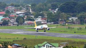 A Cebu pacific air passenger plane lands at the airport after flights to and from the city since last week were cancelled due to the stand-off between government troops and Muslim rebels in the city of Zamboanga on the southern island of Mindanao on September 19, 2013. Philippine soldiers pursued heavily armed Muslim rebels through the streets and homes of a major city September 18, warning they would be killed or captured unless they surrendered. AFP PHOTO/TED ALJIBE         (Photo credit should read TED ALJIBE/AFP/Getty Images)
