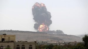 Smoke billows following an air-strike by the Saudi-led coalition on an army arms depot, now under Shiite Huthi rebel control on May 22, 2015 east of the Yemeni capital Sanaa. The Saudi-led coalition has waged an air campaign against the Huthis since March 26 in an effort to restore the authority of Hadi, who has fled to Riyadh with members of his government.  AFP PHOTO / MOHAMMED HUWAIS        (Photo credit should read MOHAMMED HUWAIS/AFP/Getty Images)