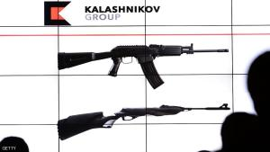 """People look at the screen during the presentation of the new logo of the Kalashnikov company in Moscow on December 2, 2014. The legendary Russian weapons manufacturer Kalashnikov hit by US sanctions, Tuesday presented its new logo to """"promote more effectively"""" products, whose most famous rifles in the world AK-47. The logo executed in red and black - the colors of the flag of Udmurtia (Urals) where are the main plants of the company Kalashnikov - represents a large letter """"K"""" like in shape to the charger AK-47. AFP PHOTO / VASILY MAXIMOV        (Photo credit should read VASILY MAXIMOV/AFP/Getty Images)"""