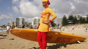 SYDNEY, AUSTRALIA - FEBRUARY 04:  Mecca Laa Laa wears a 'Burqini' on her first surf lifesaving patrol at North Cronulla Beach February 4, 2007 in Sydney, Australia. The red and yellow 'Burqini' was specially designed for Muslim lifesavers to allow females to fulfil both their patrolling and religious obligations.  (Photo by Matt King/Getty Images)