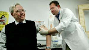 FILE PHOTO Donald A. Henderson pictured receiving a small pox vaccination in Atlanta. REUTERS/File Photo