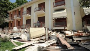 CAVEZZO, ITALY - MAY 29:  Buildings are destroyed following a 5.8 magnitude earthquake on May 29, 2012 in Bologna, Italy. The Emilia-Romagna region was again stricken by a series of strong earthquakes, some reaching 5.8 on the richter scale, with the death toll rising to at least 16 people.  (Photo by Roberto Serra/Iguana Press/Getty Images)